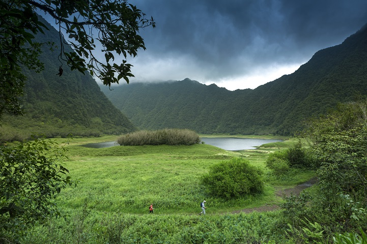 02 Dec 2013, St.-Benoit --- France, Reunion Island, Parc National de la Reunion (National Park of la Reunion), listed as World Heritage by UNESCO, Saint Benoit, Grand Etang, natural landscape of a lake surrounded by mountains under a stormy sky --- Image by © SPANI Arnaud/Hemis/Corbis