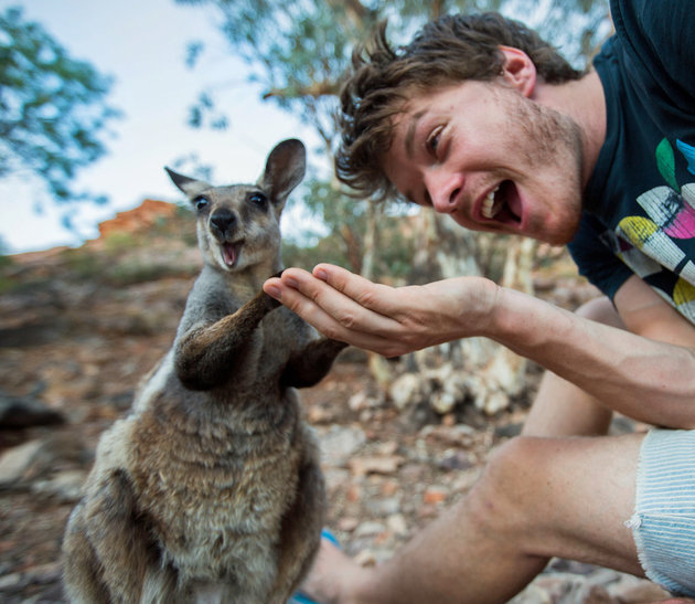 PIC BY @DAXON / CATERS NEWS - (PICTURED: Allan Dixon takes selfie with wallaby) This real-life Dr. Dolittle walks with the animals, talks with the animals, and... TAKES SELFIES with them. Traveller Allan Dixon has amassed a hilarious collection of shots with a variety of exotic creatures. Included in the 29-year-olds collection are smiling snaps with the likes of kangaroos, quokkas, camels and sea lions. In some of the shots, Allan, who is originally from Wicklow, Ireland, can even be seen in festive poses, placing a Santa hat on himself or his furry friends. - SEE CATERS COPY