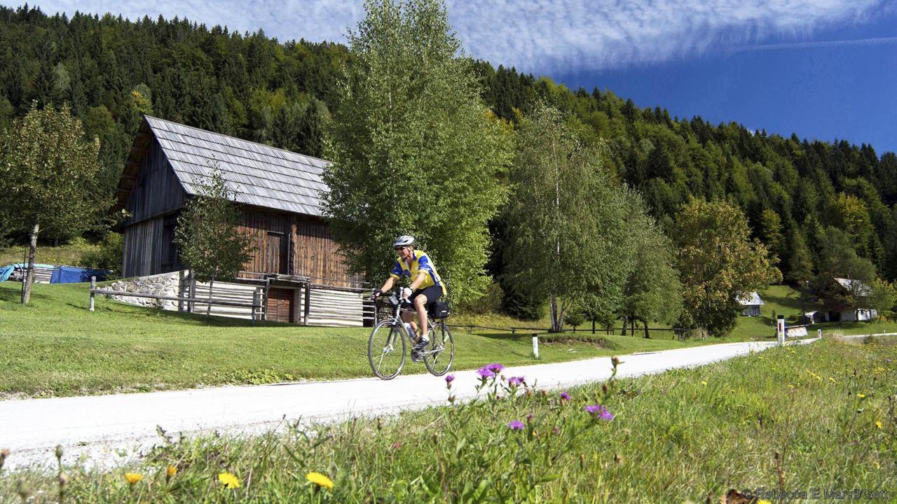 Cyclist rides through Slovenian countryside