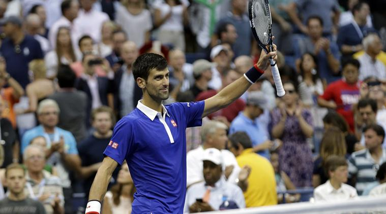 Novak Djokovic, of Serbia, waves to the crowd after beating Marin Cilic, of Croatia, during a semifinal match at the U.S. Open tennis tournament, Friday, Sept. 11, 2015, in New York. (AP Photo/Seth Wenig)